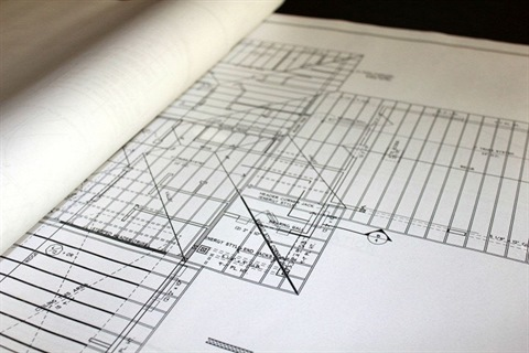 close-up-of-blueprint-on-construction-table.jpg