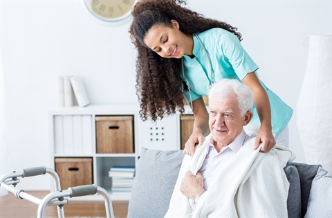 Doctor-helping-elderly-man.jpg